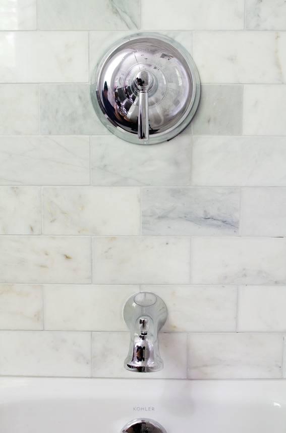 Kohler Bancroft shower fixture with marble subway tile